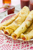 Thin pancakes crêpes with jam Stock Photography