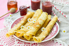 Thin pancakes crêpes with jam. And smoothie Stock Photography