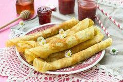 Thin pancakes crêpes with jam Stock Photo