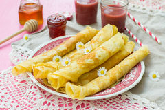 Thin pancakes crêpes with jam. And smoothie Royalty Free Stock Photo