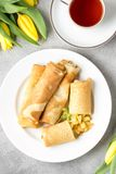 Thin pancakes (crepes) with apple filling, stuffed rolls, Russian traditional food for maslenitsa, French dessert, breakfast with. Tulips on mother\'s day royalty free stock photos