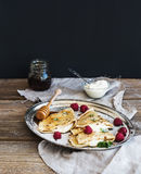 Thin pancakes or crepes with fresh raspberry, cream, mint, on a Royalty Free Stock Photography