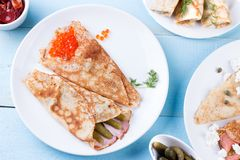 Thin pancakes, crepes with red caviar, salmon Stock Photography