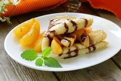 Thin Pancakes (crepes) With Peaches Royalty Free Stock Image
