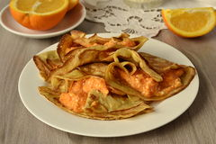 Thin pancakes filled with pumpkin and cottage cheese cream Stock Images