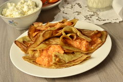 Thin pancakes filled with pumpkin and cottage cheese cream Royalty Free Stock Image
