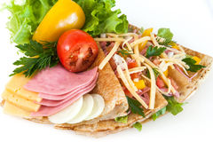 Thin pancakes with ham, cheese and vegetables Stock Photography