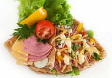 Thin pancakes with ham, cheese and vegetables Royalty Free Stock Photo