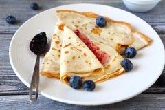 Thin pancakes with jam Royalty Free Stock Photos