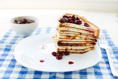 Thin pancakes on a plate Royalty Free Stock Photography