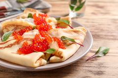Thin pancakes with red caviar. On plate Stock Images