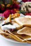Thin pancakes with sour cream Royalty Free Stock Photos