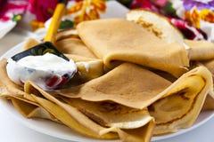 Thin pancakes with sour cream Stock Photo
