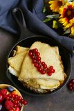 Thin pancakes stack. In a frying pan, rustic still life royalty free stock images