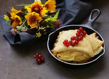 Thin pancakes stack. In a frying pan, rustic still life royalty free stock photos