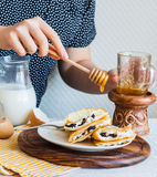 Thin pancakes stuffed with cheese, prunes and sour cream, add ho Royalty Free Stock Photography