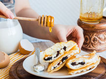 Thin pancakes stuffed with cheese, prunes and sour cream, add ho Royalty Free Stock Images