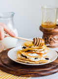 Thin pancakes stuffed with cheese, prunes and sour cream, add ho Stock Images