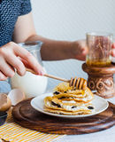 Thin pancakes stuffed with cheese, prunes and sour cream, add ho Royalty Free Stock Image