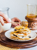 Thin pancakes stuffed with cheese, prunes and sour cream, add ho Royalty Free Stock Photo
