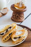 Thin pancakes stuffed with cheese, prunes and sour cream, milk Royalty Free Stock Photos