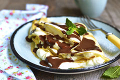 Thin pancakes stuffed with mascarpone and whipped cream. Royalty Free Stock Photography