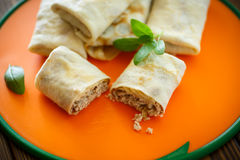 Thin pancakes stuffed with meat Stock Photos