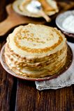 Thin pancakes on a wooden table Stock Photography