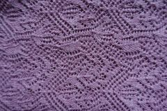 Thin pink handmade knitted lace from above stock images