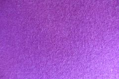 Thin pinkish violet knitted fabric. From above Royalty Free Stock Photos