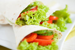 Thin pita bread and fresh vegetables Royalty Free Stock Photo