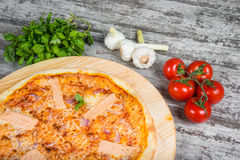 Thin pizza with salmon red fish, rosemary and spices on a ligh Stock Photo