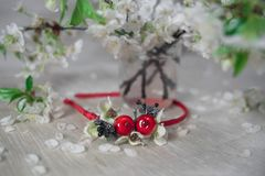 Thin red wreath with cherry blossom. Thin red wreath  cherry blossom. Flower crown Stock Photo