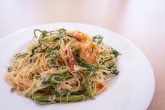 Thin rice noodles stir fried with shrimp and water minosa stock image