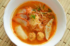 Thin rice noodles topping slice barbecue pork and prawn ball in tom yum soup Royalty Free Stock Images