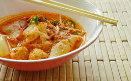 Thin rice noodles topping slice roasted pork and prawn ball in tom yum soup Stock Photography