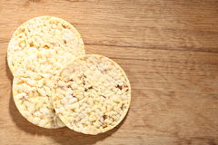 Thin round corn cakes on wooden background Stock Photography