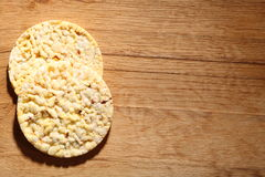 Thin round corn cakes on wooden background Royalty Free Stock Image
