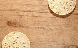 Thin round corn cakes on wooden background Stock Photo