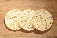 Thin round corn cakes on wooden background Stock Photos