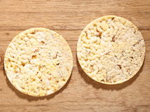 Thin round corn cakes on wooden background Royalty Free Stock Photos