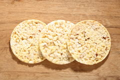 Thin round corn cakes on wooden background Stock Image