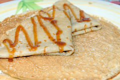 Thin russian pancakes on the plate. Maslenitsa is coming Stock Images
