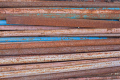 Thin rusty pipes. Lying horizontally thin rusty metal pipes Stock Images