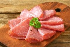 Thin salami slices Royalty Free Stock Photos