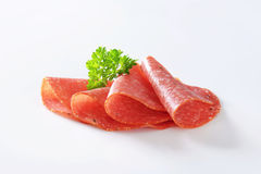 Thin salami slices Royalty Free Stock Photos
