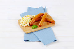 Thin sausages with potato salad Royalty Free Stock Photo