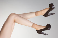 Thin short stockings on sexy legs with high heels Stock Photo