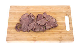 Thin sliced chuck roast on cutting board Royalty Free Stock Photo