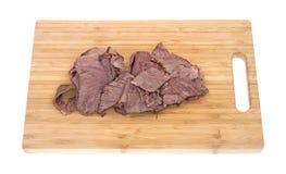 Thin sliced chuck roast on cutting board Royalty Free Stock Photo